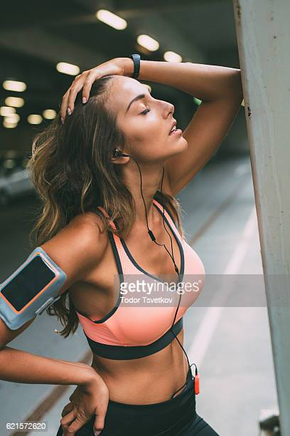 sportswoman resting - dark clothes stock photos and pictures
