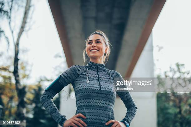sportswoman resting - low angle view stock pictures, royalty-free photos & images