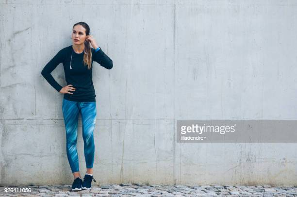 sportswoman resting - trousers stock pictures, royalty-free photos & images