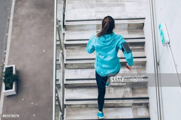 Sportswoman running up the stairs