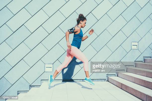 sportswoman sports training - fitness tracker stock pictures, royalty-free photos & images