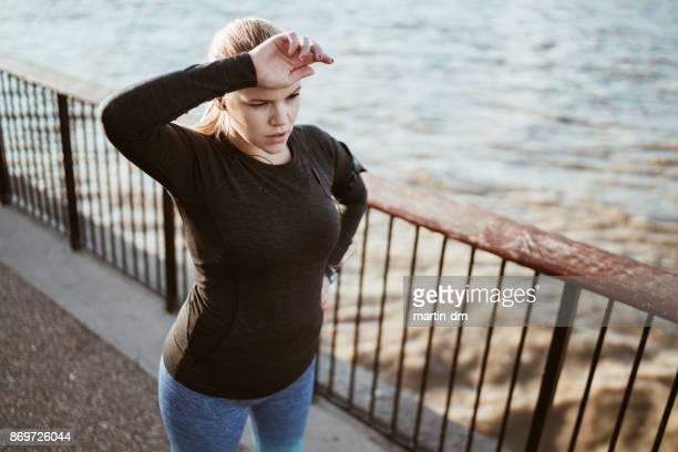 Sportswoman taking a breath