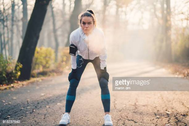 Sportswoman taking a breath