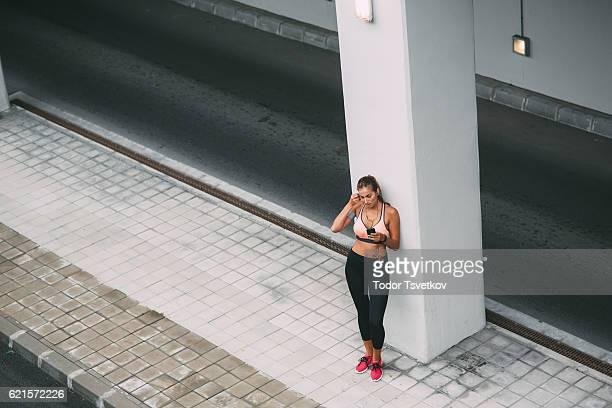 Sportswoman texting