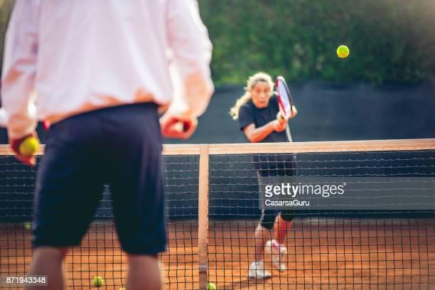 Sportswoman Training Tennis With Tennis Instruction