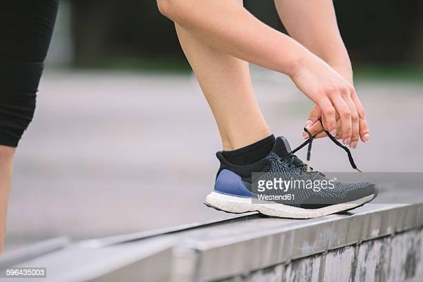 Sportswoman tying shoe