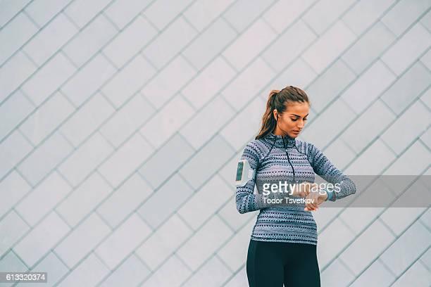 Sportswoman using a smart watch