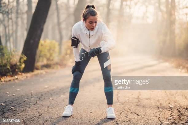 Sportswoman using fitness tracker