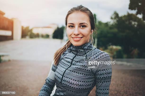 Sportswoman with headphones