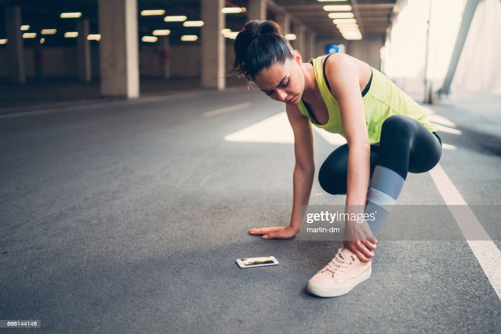Sportswoman with injured ankle : Stock Photo
