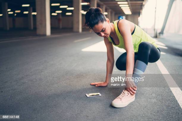sportswoman with injured ankle - sprain stock pictures, royalty-free photos & images