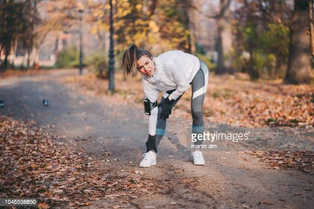 sportswoman with sprained ankle - sprain stock pictures, royalty-free photos & images
