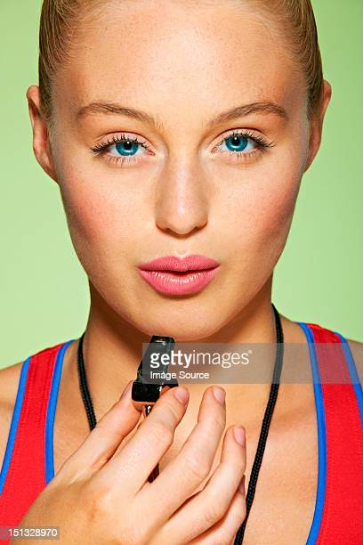 Sportswoman with whistle