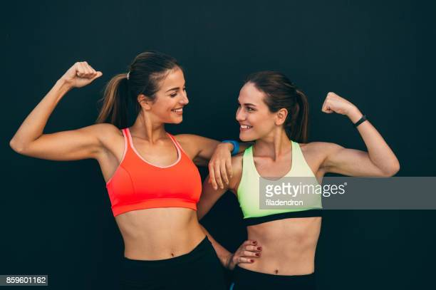 Sportswomen flexing their muscles