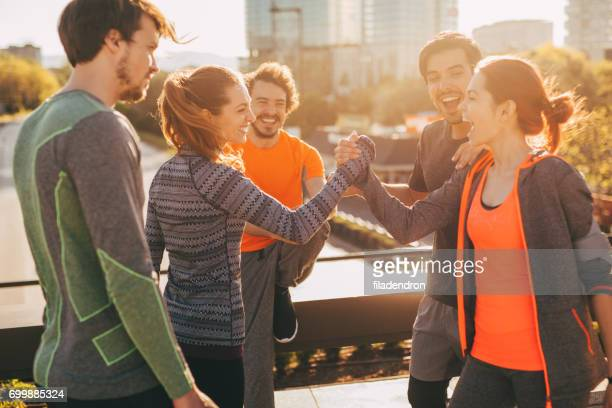 sportswomen greeting each other - sports team event stock photos and pictures
