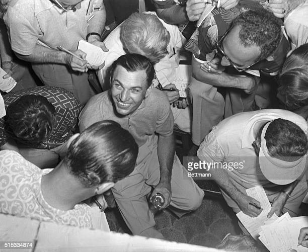 Sportswriters close in on Ben Hogan at the Oakland Hills Country Club near Birmingham Michigan after the bantam battler from Texas retained his US...