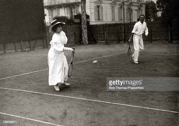 Sport/Tennis France A picture showing the typical fashion worn by the women playing in the South of France This photograph is from an album covering...