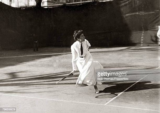 Sport/Tennis France Miss Darbyshire wearing typical tennis fashion for 1906 with long ankle length skirt and tie her hair 'up' in a bun playing in...