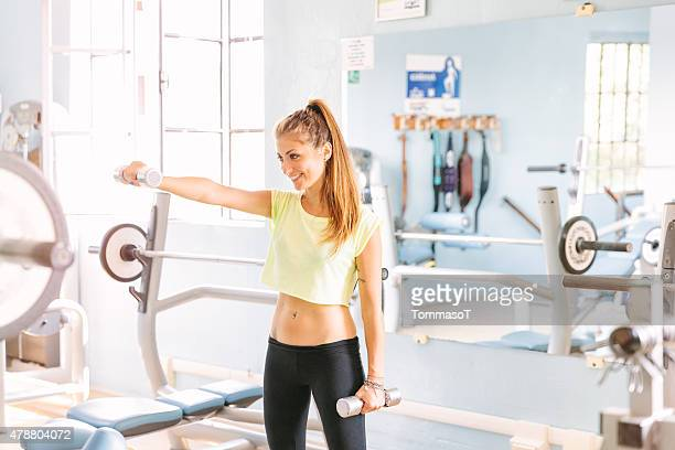 Sporty athletic young woman training at the gym