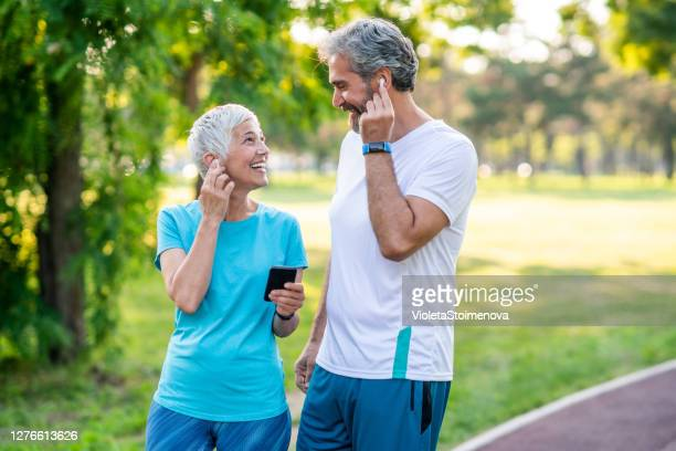 sporty couple jogging - 50 59 years stock pictures, royalty-free photos & images