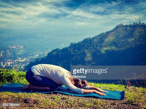 sporty fit woman practices yoga asana balasana highres
