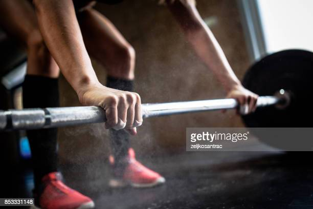 sporty girl lifting weights in gym - endurance stock pictures, royalty-free photos & images