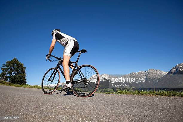 Sporty man on racing bicycle