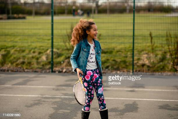sporty smiles - tennis stock pictures, royalty-free photos & images