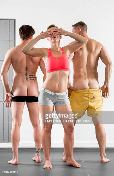 sporty woman and two sporty men - women mooning stock photos and pictures