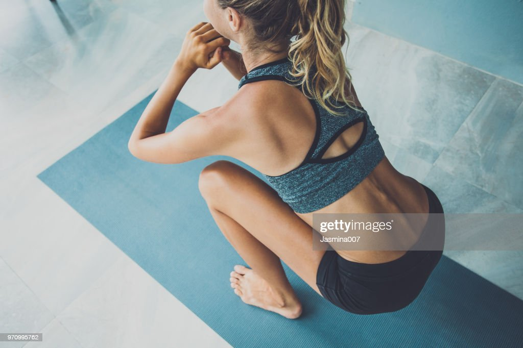 Sporty woman doing exercise in a gym : Stock Photo