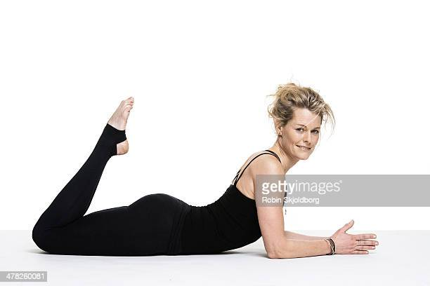 Sporty woman doing yoga exercise on floor