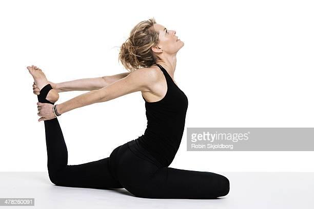 Sporty woman doing yoga exercise on floor