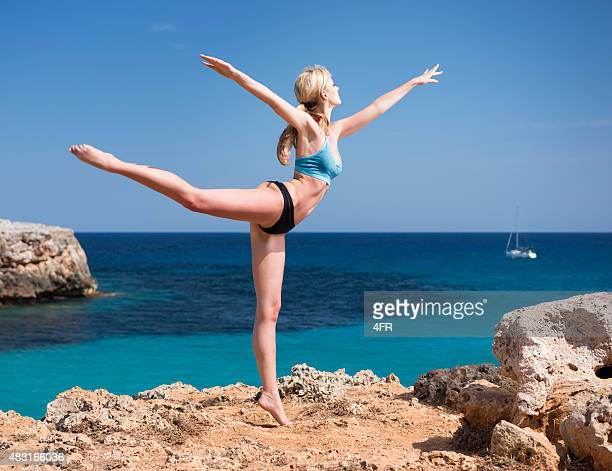Sporty Woman in an acrobatic Pose, Feeling Nature, Pure Lifestyle