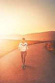 https://www.istockphoto.com/photo/sporty-woman-running-in-nature-gm977425634-265749795