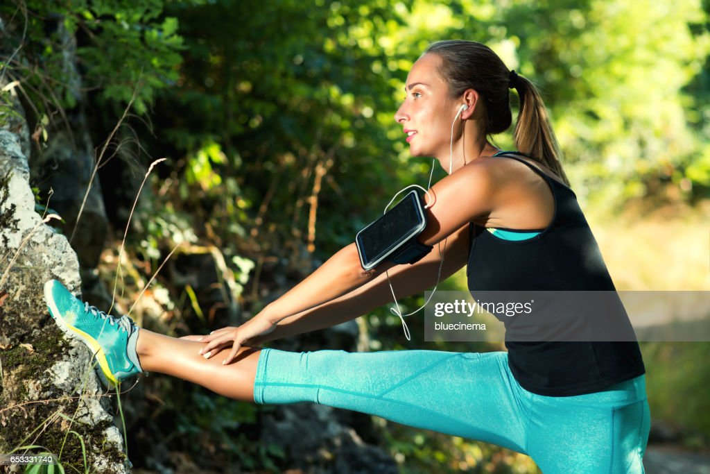 Sporty Woman Stretching Legs : Foto stock
