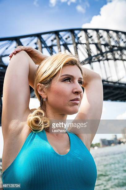 sporty woman warming up in sydney outdoor park - eastern european descent stock pictures, royalty-free photos & images