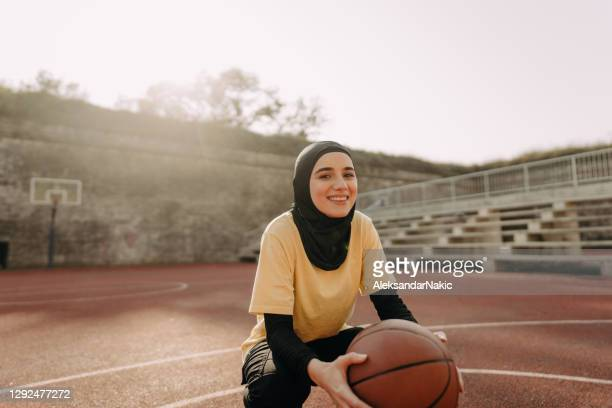 sporty woman with a hijab - religious dress stock pictures, royalty-free photos & images