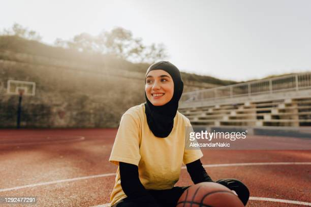 sporty woman with a hijab - sporting term stock pictures, royalty-free photos & images