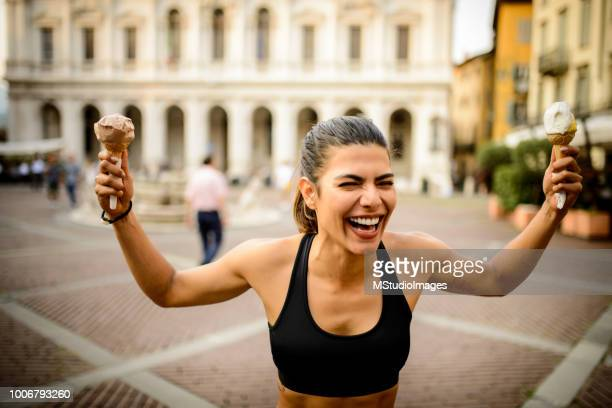 sporty woman with ice creams. - sugar food stock pictures, royalty-free photos & images