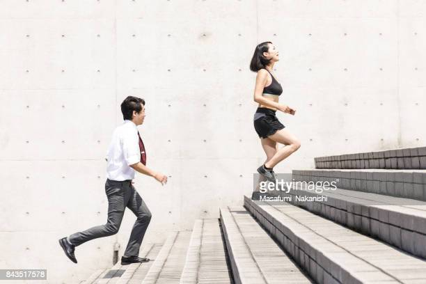 Sporty women and shortage exercise businessmen