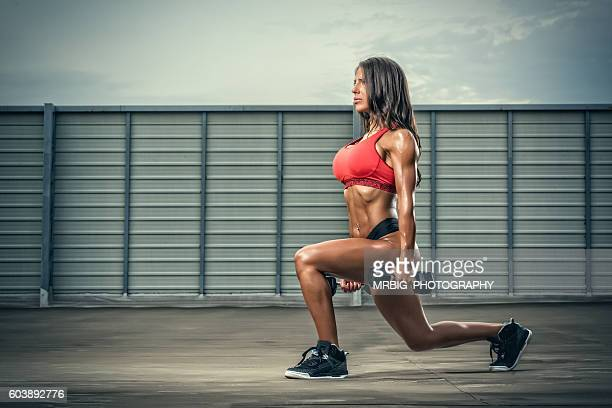 Sporty Women Exercise with Weights