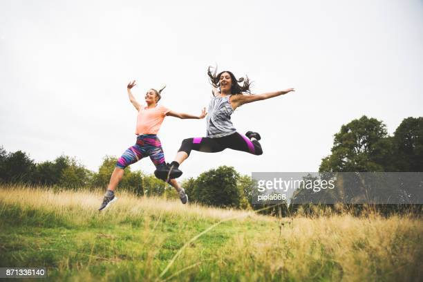 sporty women jumping together - ballerina feet stock photos and pictures