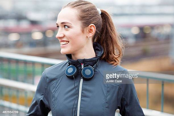 sporty young girl smiling in front of city scape