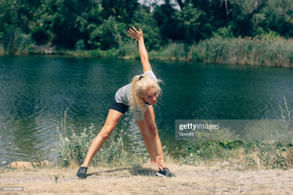 Sporty young woman is training outside : Stock Photo