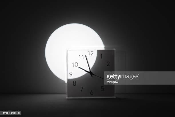 spot light focus on time - スポットライトをあてる ストックフォトと画像