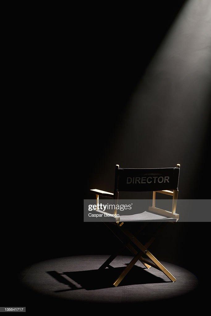 A spot lit directors chair : Stock-Foto