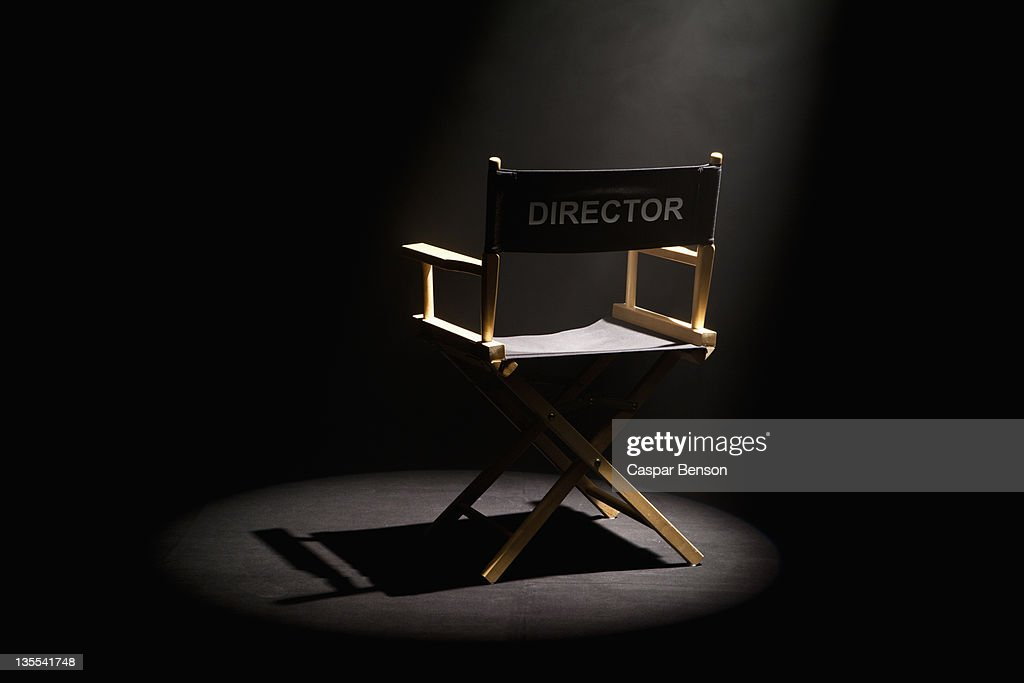 A spot lit directors chair : Stock Photo