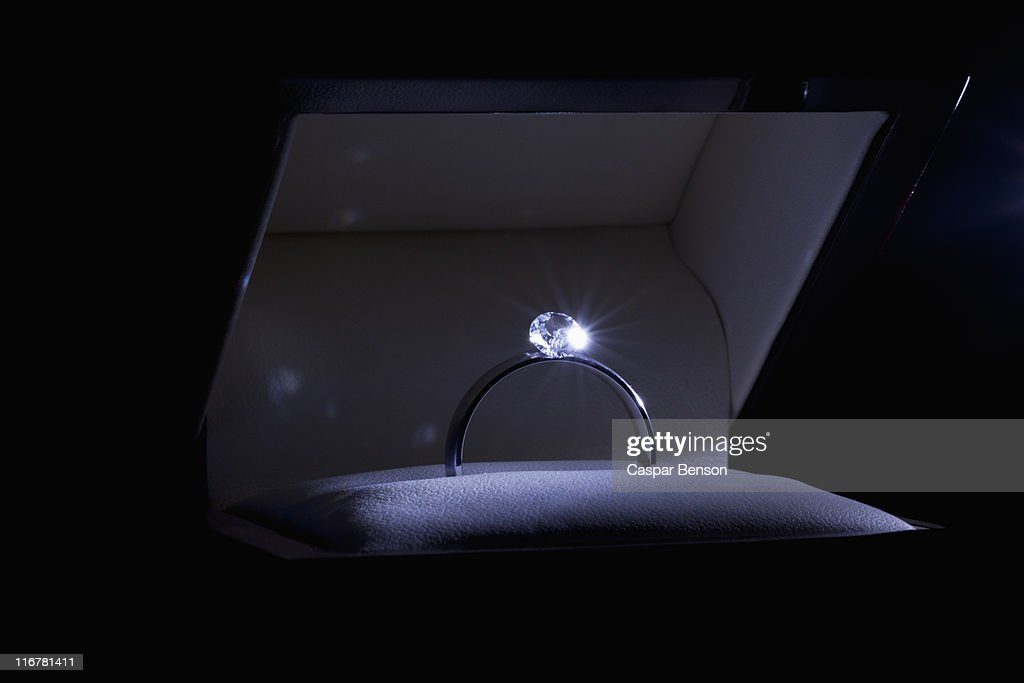 A spot lit engagement ring in a jewelry box, close-up : Stock Photo