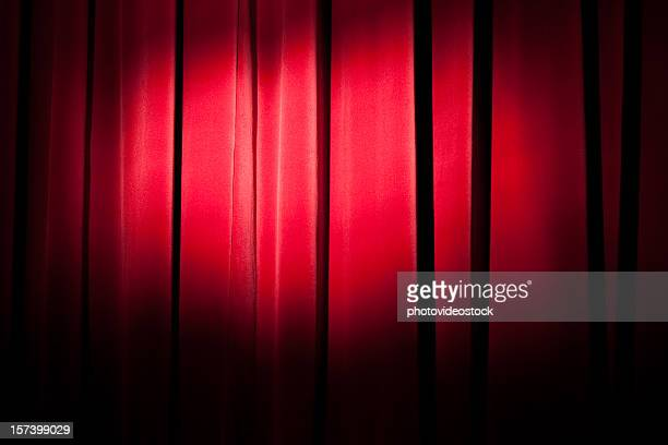 Spot over red curtain
