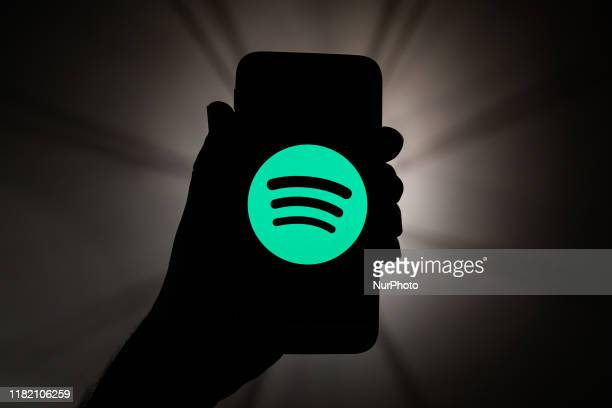 Spotify logo is seen displayed on a phone screen in this illustration photo taken in Krakow, Poland on November 11, 2019.